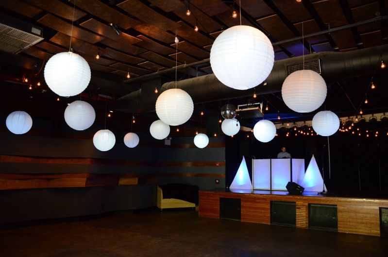 White Paper Lanterns each with a decorative LED light placed inside and suspend in a tight cluster over dance floor at Little Fields located in Brooklyn, New York
