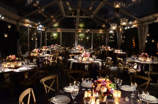 Pinspots focused on table centerpieces under tent in the courtyard at The Foundry located in Long Island City, New York