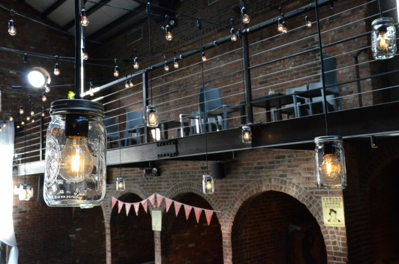 Mason Jars with string Lights suspended in the Main Room at The Foundry located in Long Island City, New York