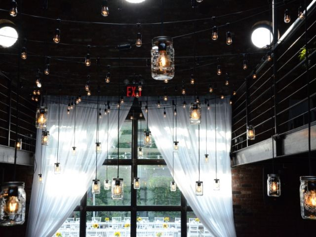 The Foundry (Long Island City, New York) - Pendant Lamps with Masson jars suspended from the mezzanine level