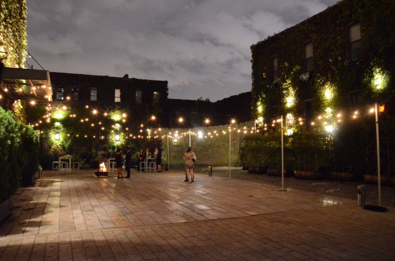 String Lights suspended from stands in the rear courtyard at The Foundry located in Long Island City, New York