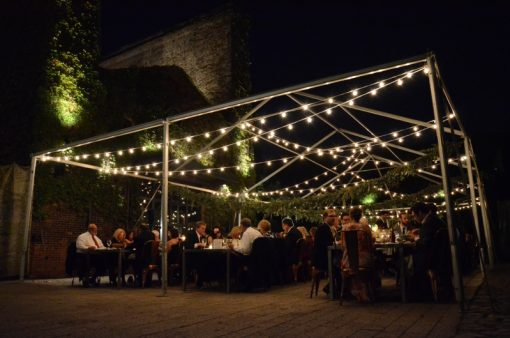 String Lights suspended under a tent frame for a wedding reception in the rear courtyard at The Foundry located in Long Island City, New York