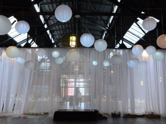 26 Bridge (Brooklyn, New York) - 25 Paper Lanterns each with a decorative LED light to provide a soft glow suspended over the ceremony with a white shear partitioning curtain.