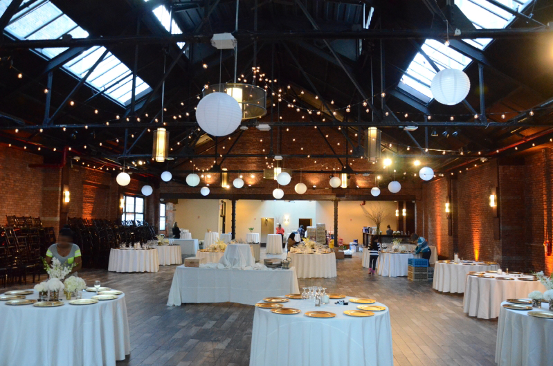 26 Bridge (Brooklyn, New York) - 400ft of String Lights suspended with G50 bulbs in Circular Pattern above the center of the main room w/ Paper Lanterns.