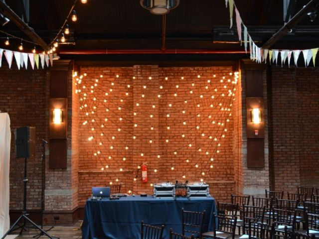 26 Bridge (Brooklyn, New York) - String Lights with G50 bulbs suspended with multiple horizontal swoops against the wall adjacent to the dance floor