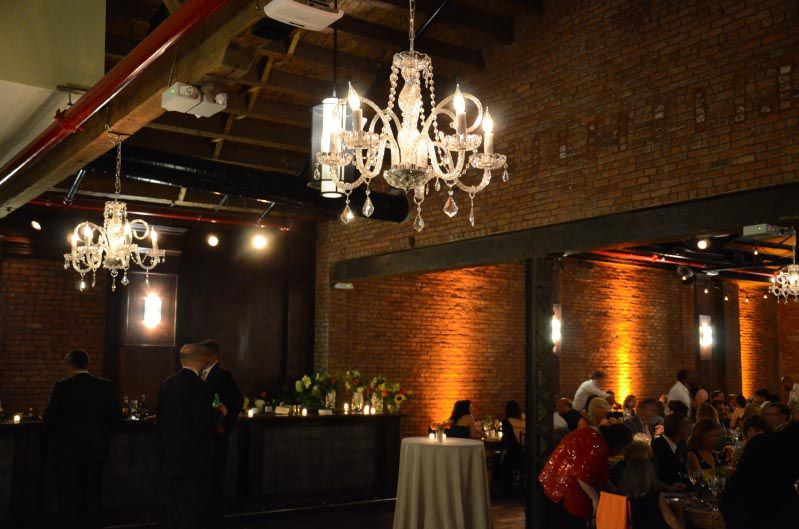 26 Bridge (Brooklyn, New York) - Chandeliers suspended in bar area with Up-Lights along perimeter of the main room