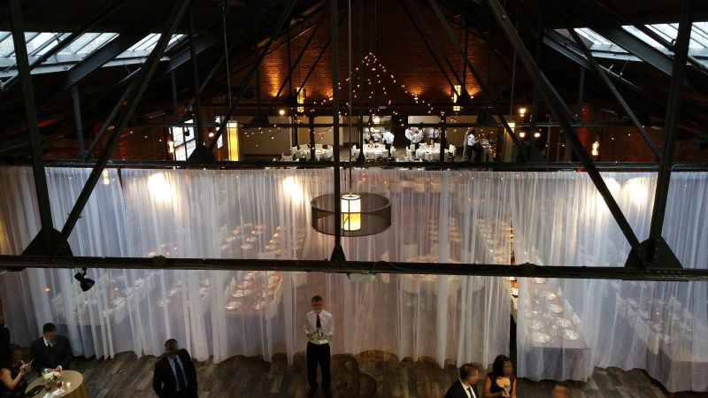 26 Bridge (Brooklyn, New York) - String Lights suspended with S14 bulbs in Zigzag pattern with chandeliers and Up-Lights along the perimeter wall of main room.