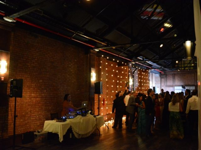 26 Bridge (Brooklyn, New York) - String Lights with G50 bulbs suspended vertically against wall adjacent to the dance floor.