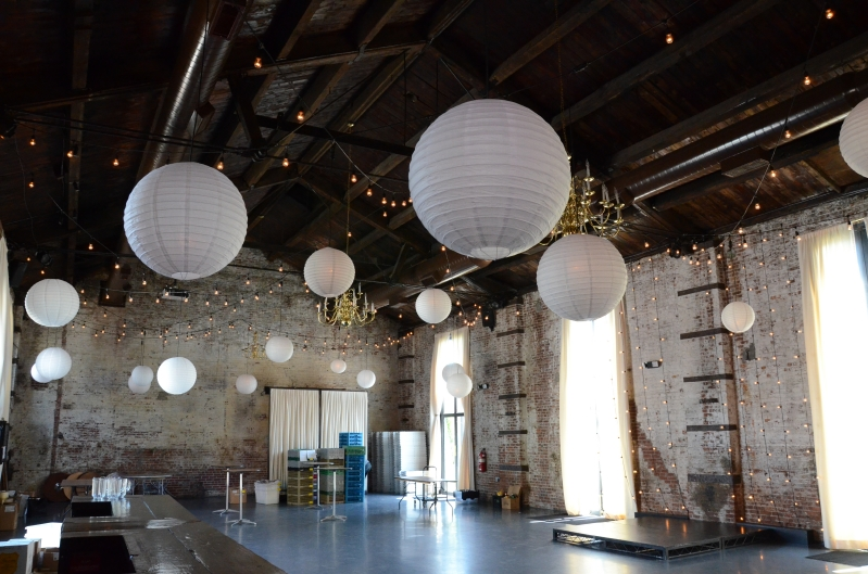String Lights suspended overhead with paper lanterns at The Green Building located in Brooklyn, New York
