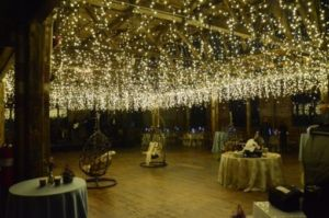 icicle fairy lights suspended between center columns at The Greenpoint Loft located in Brooklyn, New York
