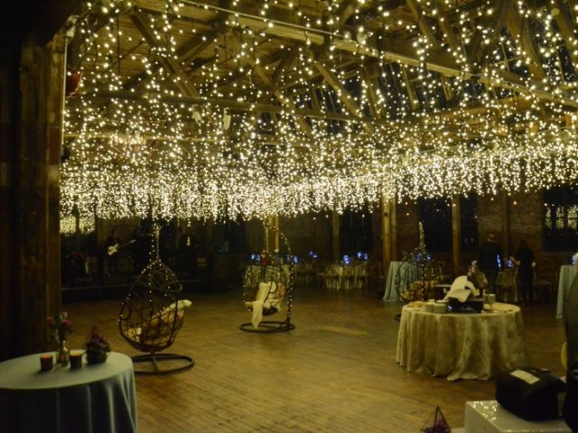 The Greenpoint Loft (Brooklyn, NY) - Icicle (Fairy) Lights suspended over the main floor.