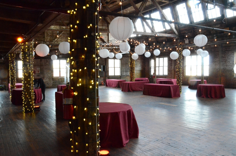The Greenpoint Loft (Brooklyn, NY) - 600ft of String Lights with S14 bulbs suspended in a circular pattern with Paper Lanterns