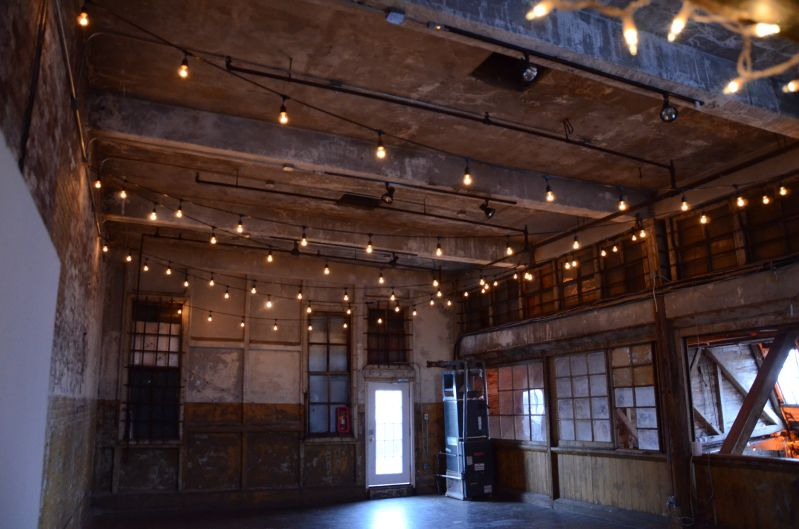 The Greenpoint Loft (Brooklyn, NY) - 150ft of String Lights suspended in a zigzagging pattern on Mezzanine Level