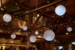 Paper Lanterns and String Lights suspended overhead in a zigzagging pattern at The Greenpoint Loft located in Brooklyn, New York