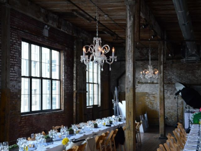 The Greenpoint Loft (Brooklyn, NY) - Chandeliers suspended to the side of the high ceiling area on the main floor.