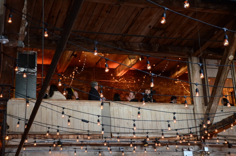 The Greenpoint Loft (Brooklyn, NY) - String Lights suspended with S14 bulbs in a Zigzag Pattern under the high ceiling area on the main floor with Up-Lights on the mezzanine level