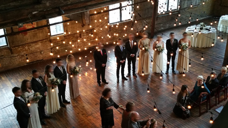 The Greenpoint Loft (Brooklyn, NY) - String Lights suspended in a V-Shaped Pattern under half the high ceiling area on the main floor