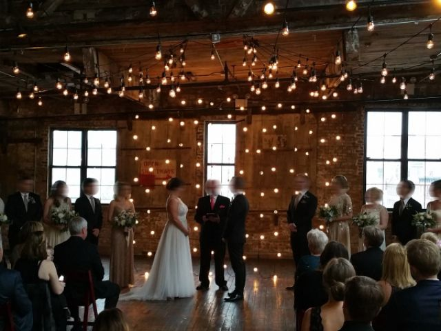 The Greenpoint Loft (Brooklyn, NY) - String Lights suspended in a V-Shaped Pattern under half the high ceiling area with String Light suspended vertically behind the ceremony area on the main floor.