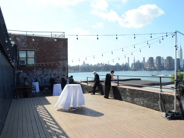 The Greenpoint Loft (Brooklyn, NY) - 150ft of String Lights with S14 bulbs suspended in a zigzag pattern from  lighting stands on the outdoor rooftop.