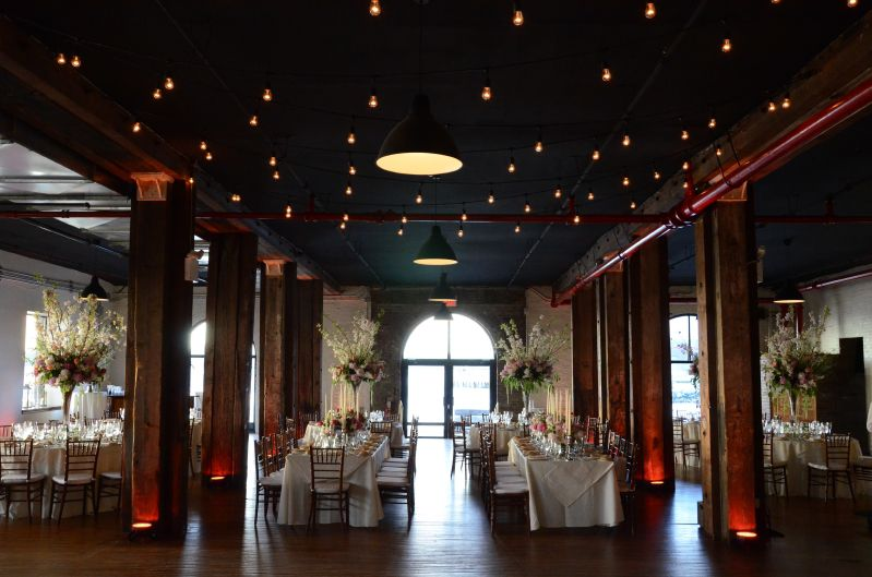 The Liberty Warehouse (Brooklyn, New York) - String Lights with S14 bulbs suspended in a Zigzag pattern over dance floor with Up-Lights on each Column