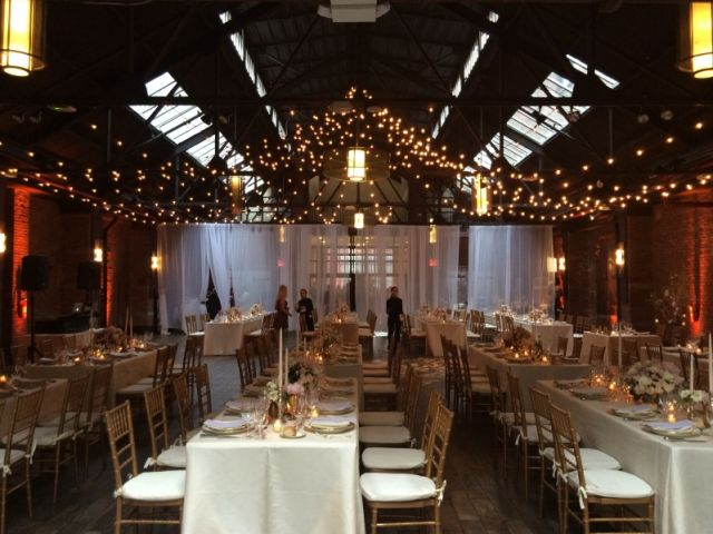 26 Bridge (Brooklyn, New York) - 600ft of String Lights suspended with G50 bulbs in a Circular Pattern above clients dance floor with a white shear partitioning curtain.
