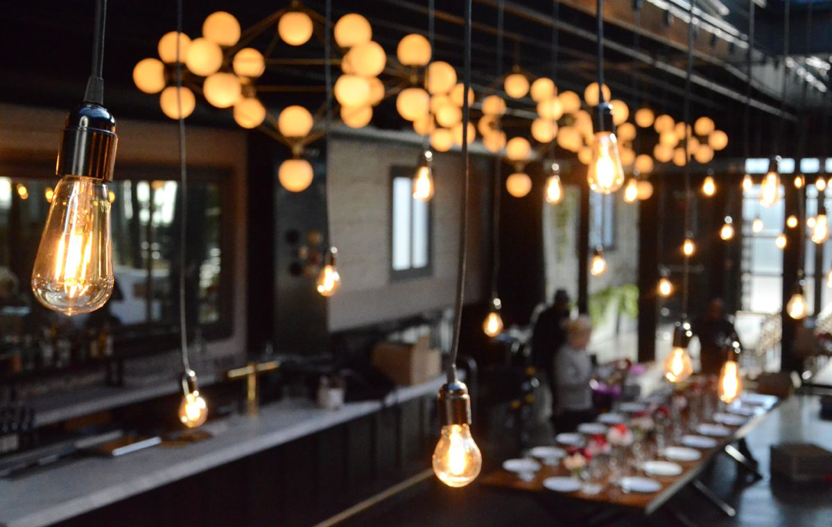 Pendant Lamps with vintage antique bulbs suspended for a wedding reception at 501 Union located in Brooklyn, New York