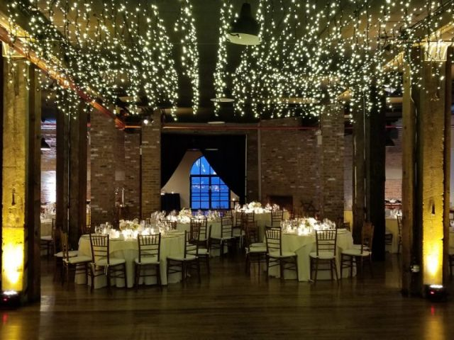 The Liberty Warehouse (Brooklyn, New York) - Icicle (Fairy) Lights suspended between center columns with Up-Lights