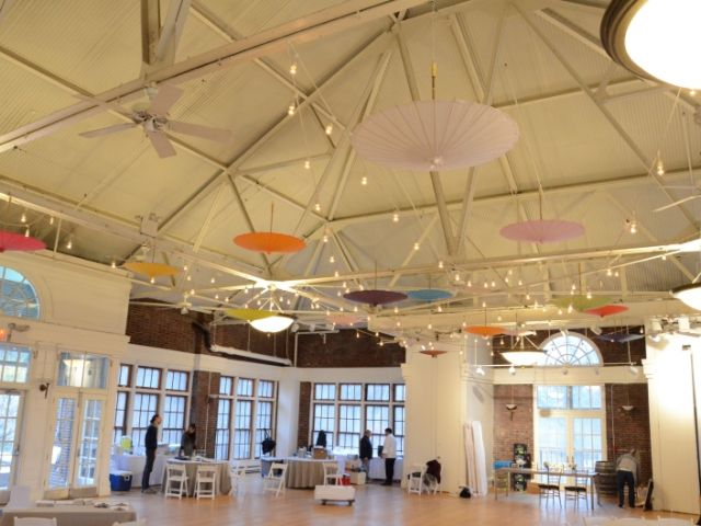 The Prospect Park Picnic House (Brooklyn, New York) - String Lights w/ various color paper parasol umbrellas suspended overhead