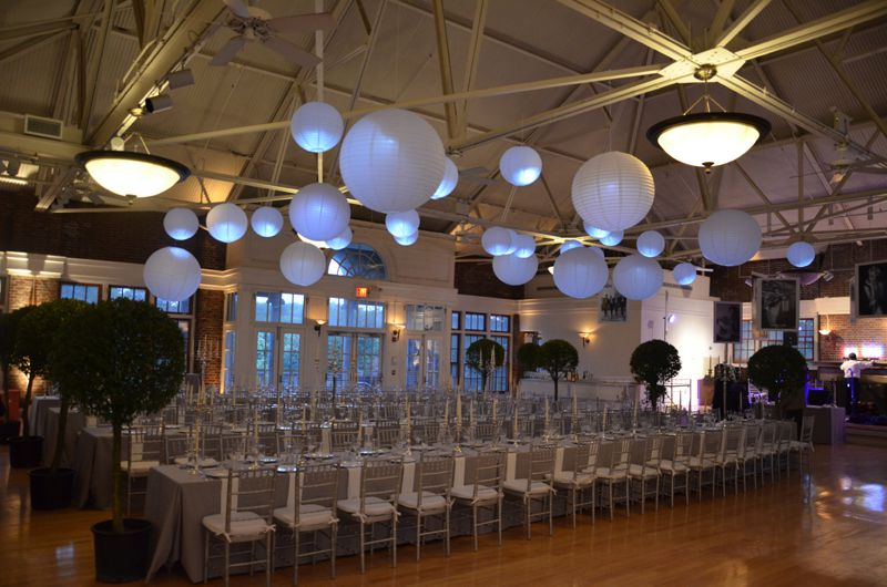 white paper lanterns suspended with a decorative LED light placed inside for a wedding at The Prospect Park Picnic House located in Brooklyn, New York