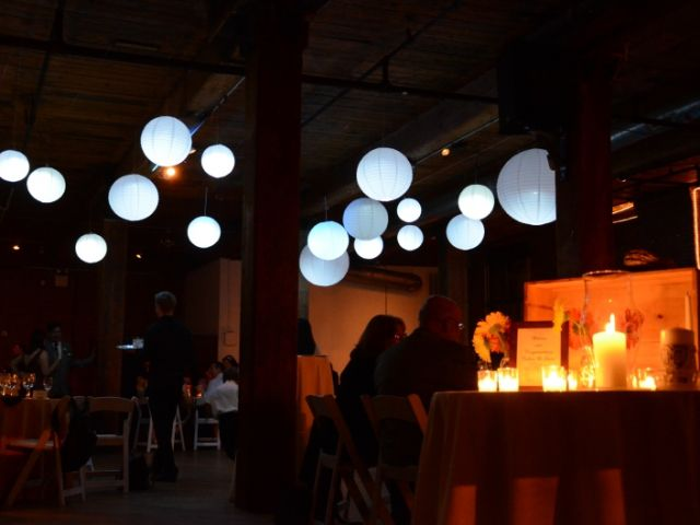 The Dumbo Loft (Brooklyn, New York) - Paper Lanterns suspended between the center columns with a decorative LED Light placed inside each lantern