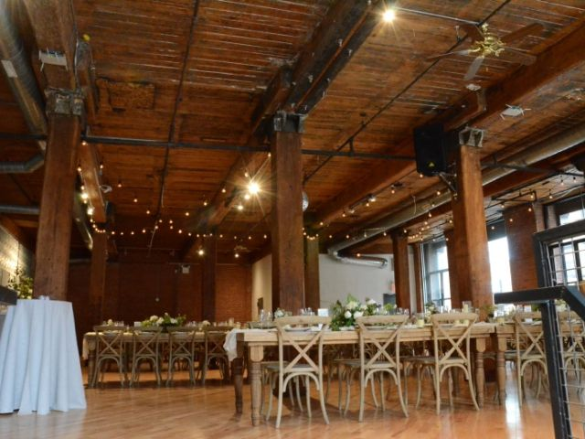 The Dumbo Loft (Brooklyn, New York) - String Lights suspended in a zigzagging pattern between center columns