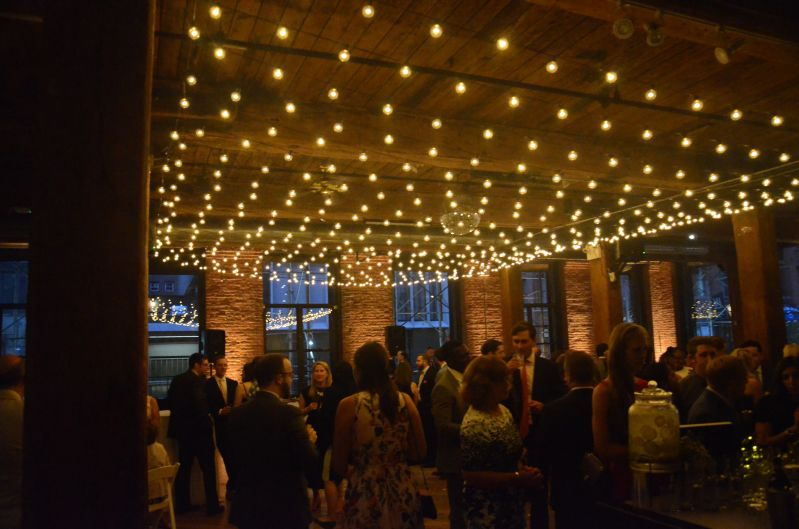 The Dumbo Loft (Brooklyn, New York) - String Light with G50 Bulbs suspended as a canopy between the center columns at The Dumbo Loft with Up-Lights along the perimeter walls