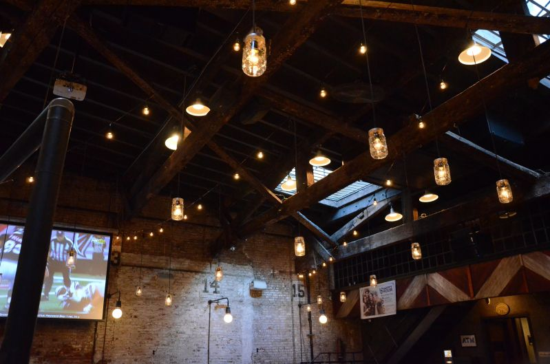 The Houston Hall (New York, NY) - String Lights suspended with Mason Jars and S14 bulbs in a V-Shaped pattern