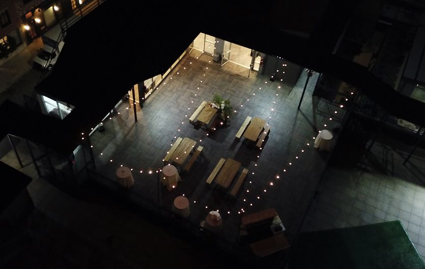The W-Loft (Brooklyn, New York) - String Lights suspended from stands above outdoor patio