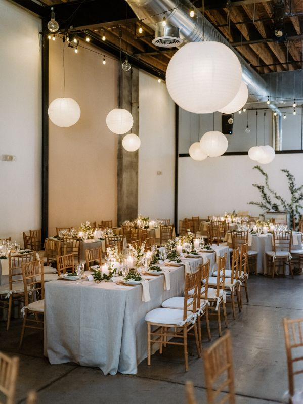 White Paper Lanterns suspended with String Lights over dining tables at Dobbin St.