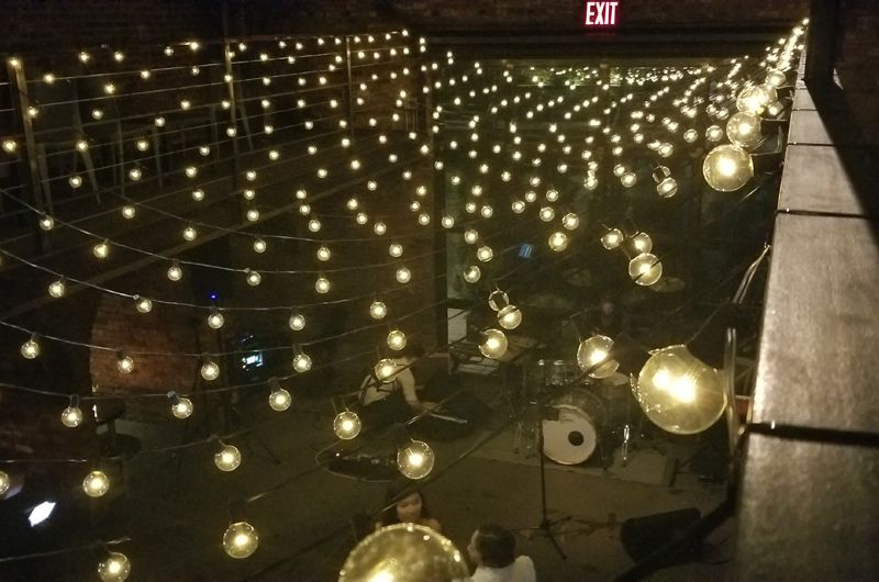 600ft of String Lights suspended with round G50 bulbs suspended as a canopy in the main room at The Foundry