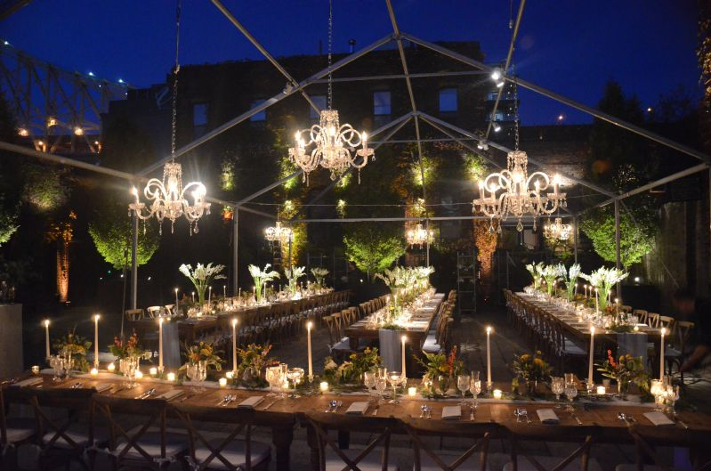 Crystal Chandeliers suspended under tent frame in the rear courtyard at The Foundry located in Long Island City, New York