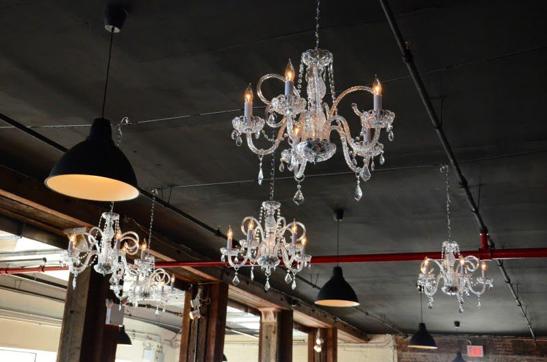 Chandeliers suspended over dance floor at The Liberty Warehouse