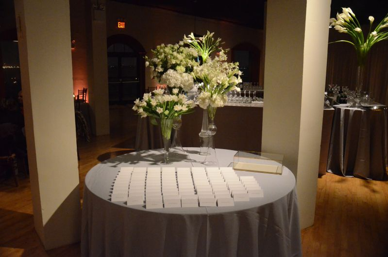 Spotlight on escort card table at The Liberty Warehouse