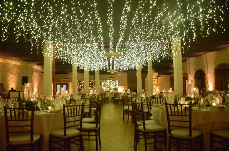 icicle fairy lights suspend columns in the 2nd floor reception room with at The Liberty Warehouse located in Brooklyn New York