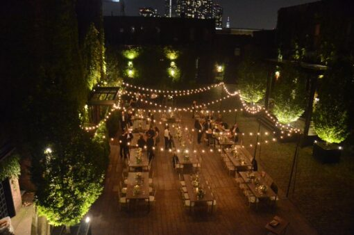String Lights suspended with stand above the rear courtyard at The Foundry located in Long Island City, New York