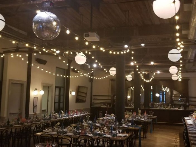 String Lights suspended in parallel lines at The Wythe Hotel and Mirror Ball w/ motor and spot light suspended over dance floor