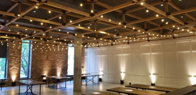 The Second Floor (Eventi Hotel) - The Great Room East - String Lights suspended overhead and warm white Up-Lights