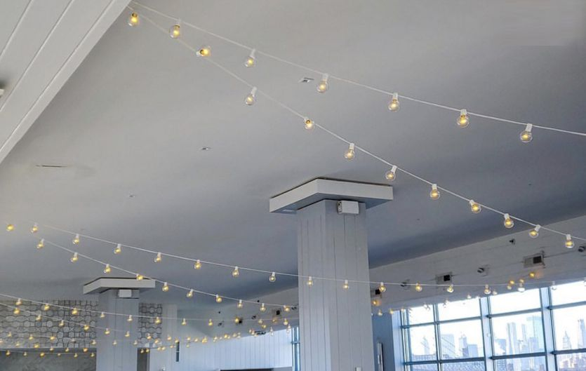 String Lights with round G50 bulbs suspended overhead for a wedding at The W-Loft located in Brooklyn, New York